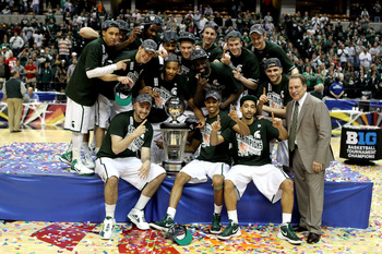 INDIANAPOLIS, IN - MARCH 11:  The Michigan State Spartans celebrate with the conference championship trophy after they won 68-64 against the Ohio State Buckeyes during the Final Game of the 2012 Big Ten Men's Conference Basketball Tournament at Bankers Li