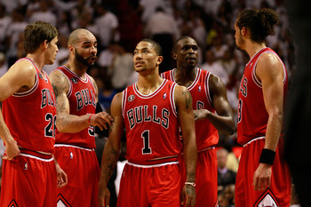 Chicago's Derrick Rose with less celebrated Bulls' teammates.