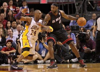 LA Lakers' Kobe Bryant defending the Miami Heat's LeBron James.
