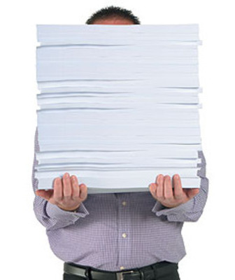 Man-with-pile-of-paper1_display_image