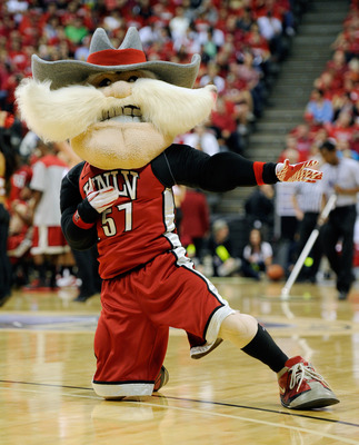 The Runnin' Rebel mascot doing the Warrior 1 pose in yoga.