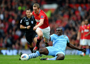 MANCHESTER, ENGLAND - OCTOBER 23:  Darren Fletcher of Manchester United is challenged by Micah Richards of Manchester City during the Barclays Premier League match between Manchester United and Manchester City at Old Trafford on October 23, 2011 in Manche