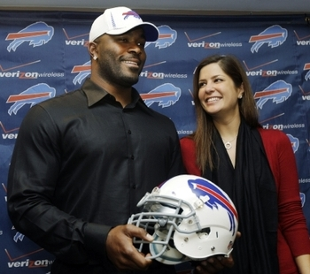 Williams and his fiancee Erin Marzouki were all smiles at his press conference.
