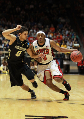 ALBUQUERQUE, NM - MARCH 15: Oscar Bellfield #0 of the UNLV Rebels handles the ball against Askia Booker #0 of the Colorado Buffaloes during the second round of the 2012 NCAA Men's Basketball Tournament at The Pit on March 15, 2012 in Albuquerque, New Mexi