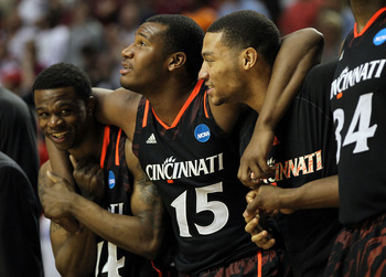 NASHVILLE, TN - MARCH 18:  Jermaine Sanders #15 of the Cincinnati Bearcats hugs his teammates on the bench against the Florida State Seminoles during the third round of the 2012 NCAA Men's Basketball Tournament at Bridgestone Arena on March 18, 2012 in Na