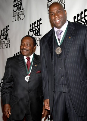 Joe Morgan (left) next to Magic Johnson (right)