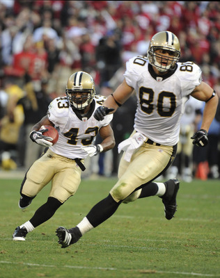Darren Sproles (left, with ball) runs behind Jimmy Graham
