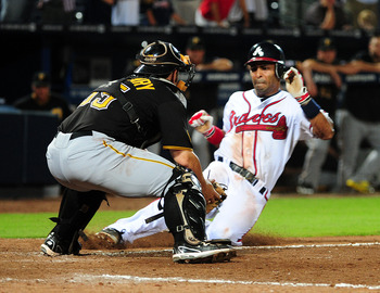 Michael McKenry looks to apply the tag in Atlanta.