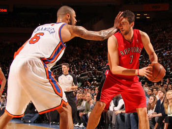 Tyson-chandler-of-the-new-york-knicks-defends-i-guess-andrea-bargnani-of-the-toronto-raptors