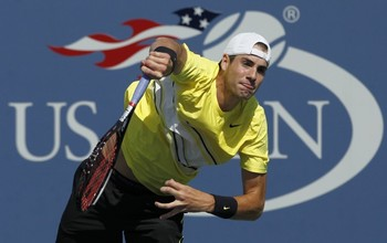 156553-john-isner-of-the-u-s-serves-to-gilles-simon-of-france-during-their-ma_display_image