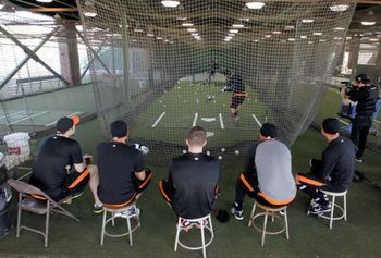 Teammates look on as Brandon Crawford takes BP in Scottsdale.