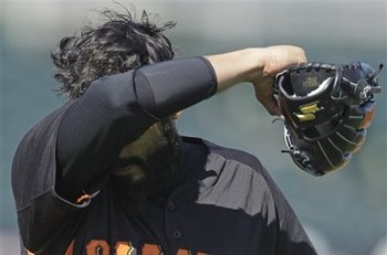 Sergio Romo attempts to heal his injured elbow with mind powers.