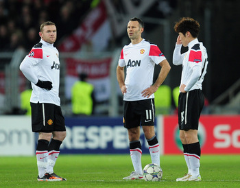 BASEL, SWITZERLAND - DECEMBER 07:  Wayne Rooney, Ryan Giggs and Park Ji-Sung of Manchester United look on after Marco Streller of Basel scored the opening goal during the UEFA Champions League Group C match between FC Basel 1893 and Manchester United at S