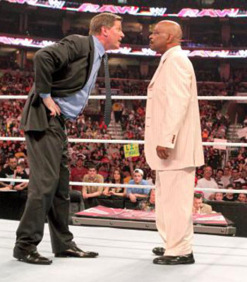 John Laurenitus and Teddy Long, photo copyright to WWE.com