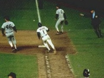 Bill Buckner watches the grounder that changed his life.