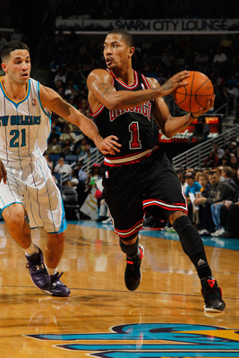 NEW ORLEANS, LA - FEBRUARY 08:  Derrick Rose #1 of the Chicago Bulls drives the ball around Greivis Vasquez #21 of the New Orleans Hornets  at New Orleans Arena on February 8, 2012 in New Orleans, Louisiana.  NOTE TO USER: User expressly acknowledges and