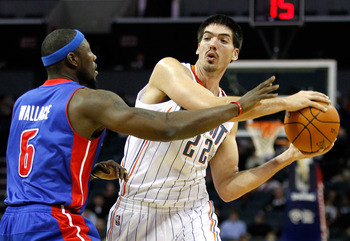 CHARLOTTE, NC - JANUARY 13:  Byron Mullens #22 of the Charlotte Bobcats tries to keep the ball away from Ben Wallace #6 of the Detroit Pistons during their game at Time Warner Cable Arena on January 13, 2012 in Charlotte, North Carolina. NOTE TO USER: Use