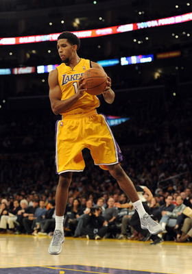 LOS ANGELES, CA - DECEMBER 19:  Darius Morris #1 of the Los Angeles Lakers grabs a rebound during the game against the Los Angeles Clippers at Staples Center on December 19, 2011 in Los Angeles, California. NOTE TO USER: User expressly acknowledges and ag
