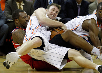 CHARLOTTE, NC - JANUARY 28:  Trevor Booker #35 of the Washington Wizards battles for the loose ball with Matt Carroll #33 of the Charlotte Bobcats during their game at Time Warner Cable Arena on January 28, 2012 in Charlotte, North Carolina. NOTE TO USER: