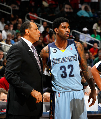 ATLANTA, GA - FEBRUARY 02:  O.J. Mayo #32 and Lionel Hollins of the Memphis Grizzlies against the Atlanta Hawks at Philips Arena on February 2, 2012 in Atlanta, Georgia.  NOTE TO USER: User expressly acknowledges and agrees that, by downloading and or usi