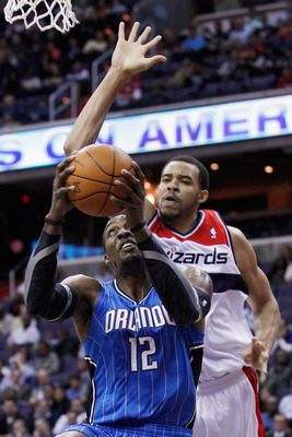 WASHINGTON, DC - FEBRUARY 29: Dwight Howard #12 of the Orlando Magic puts up a shot in front of JaVale McGee #34 of the Washington Wizards during the first half at the Verizon Center on February 29, 2012 in Washington, DC. NOTE TO USER: User expressly ack