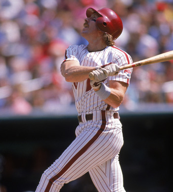 Mike Schmidt watches one of his 548 home runs fly out of the park.