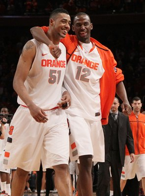 NEW YORK, NY - MARCH 08:  Fab Melo #51 and Baye Keita #12 of the Syracuse Orange celebrate after defeating the Connecticut Huskies during their quarterfinal game of the 2012 Big East Men's Basketball Tournament at Madison Square Garden on March 8, 2012 in