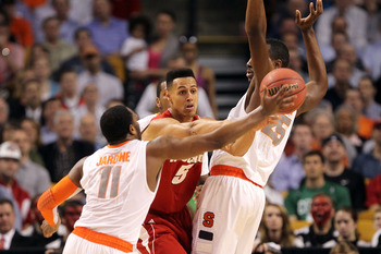 BOSTON, MA - MARCH 22:  Ryan Evans #5 of the Wisconsin Badgers handles the ball against Rakeem Christmas #25 and Scoop Jardine #11 of the Syracuse Orange during their 2012 NCAA Men's Basketball East Regional Semifinal game at TD Garden on March 22, 2012 i