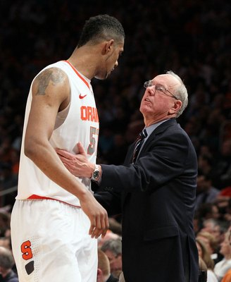 NEW YORK, NY - MARCH 08:  Fab Melo #51 and head coach Jim Boeheim of the Syracuse Orange against the Connecticut Huskies during their quarterfinal game of the 2012 Big East Men's Basketball Tournament at Madison Square Garden on March 8, 2012 in New York