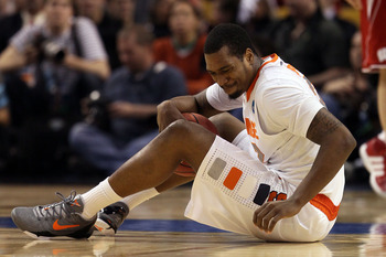 BOSTON, MA - MARCH 22:  Kris Joseph #32 of the Syracuse Orange reacts while sitting on the court against the Wisconsin Badgers during their 2012 NCAA Men's Basketball East Regional Semifinal game at TD Garden on March 22, 2012 in Boston, Massachusetts.  (