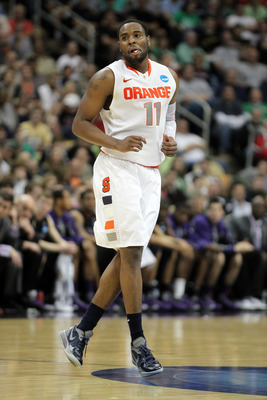PITTSBURGH, PA - MARCH 17:  Scoop Jardine #11 of the Syracuse Orange reacts against the Kansas State Wildcats in the second half during the third round of the 2012 NCAA Men's Basketball Tournament at Consol Energy Center on March 17, 2012 in Pittsburgh, P