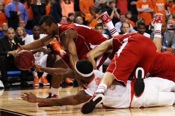 BOSTON, MA - MARCH 22:  Jordan Taylor #11 of the Wisconsin Badgers fights for a loose ball against C.J. Fair #5 of the Syracuse Orange during their 2012 NCAA Men's Basketball East Regional Semifinal game at TD Garden on March 22, 2012 in Boston, Massachus