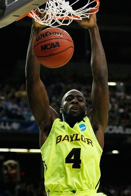 ATLANTA, GA - MARCH 23:  Quincy Acy #4 of the Baylor Bears dunks against the Xavier Musketeers in the second half during the 2012 NCAA Men's Basketball South Regional Semifinal game at the Georgia Dome on March 23, 2012 in Atlanta, Georgia.  (Photo by Kev