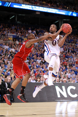 ST. LOUIS, MO - MARCH 23:  Thomas Robinson #0 of the Kansas Jayhawks drives for a shot attempt in the first half against C.J. Williams #21 of the North Carolina State Wolfpack during the 2012 NCAA Men's Basketball Midwest Regional Semifinal at Edward Jone