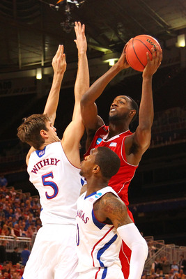 ST. LOUIS, MO - MARCH 23: C.J. Leslie #5 of the North Carolina State Wolfpack drives for a shot attempt in the first half against Jeff Withey #5 and Thomas Robinson #0 of the Kansas Jayhawks during the 2012 NCAA Men's Basketball Midwest Regional Semifinal