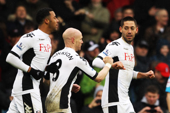 LONDON, ENGLAND - MARCH 04:  Fulham's Clint Dempsey	(R) celebrates after scoring a goal during the Barclays Premier League match between Fulham and Wolverhampton Wanderers at Craven Cottage on March 4, 2012 in London, England.  (Photo by Scott Heavey/Gett