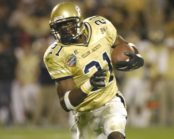 Georgia Tech wide receiver Calvin Johnson  rushes upfield against Syracuse  in the Champs Sports Bowl at the Florida Citrus Bowl, Orlando, Florida Dec 21, 2004.  Georgia Tech defeated Syracuse. (Photo by A. Messerschmidt/Getty Images)