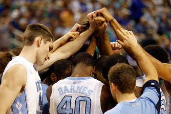 GREENSBORO, NC - MARCH 16:  The North Carolina Tar Heels huddle up before playing against the Vermont Catamounts during the second round of the 2012 NCAA Men's Basketball Tournament at Greensboro Coliseum on March 16, 2012 in Greensboro, North Carolina.