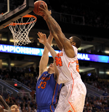 Louisville's Chane Behanan fights for a basket.