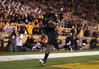 TEMPE, AZ - NOVEMBER 19:  Wide receiver Gerell Robinson #8 of the Arizona State Sun Devils scores on a 11 yard touchdown reception against the Arizona Wildcats during the second quarter of the college football game at Sun Devil Stadium on November 19, 201