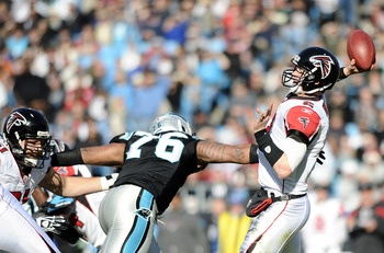 Greg Hardy (76) pressures the Falcons' quarterback Matt Ryan.