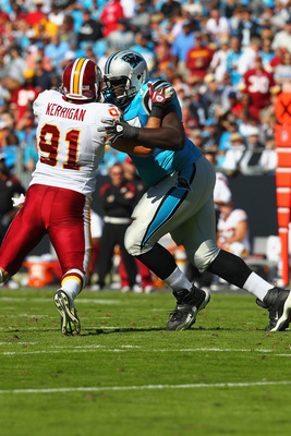 Byron Bell (77) blocking the Redskins' Ryan Kerrigan.