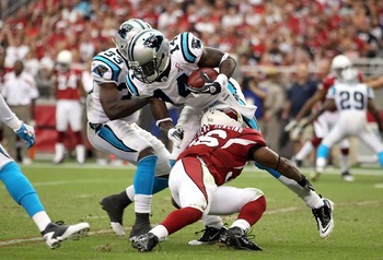 Armanti Edwards (14) is tackled after fielding a punt against the Arizona Cardinals.