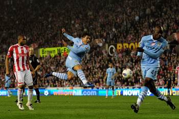 STOKE ON TRENT, ENGLAND - MARCH 24:  Carlos Tevez of Manchester City lashes a shot towards the Stoke goal during the Barclays Premier League match between Stoke City and Manchester City at the Britannia Stadium on March 24, 2012 in Stoke on Trent, England