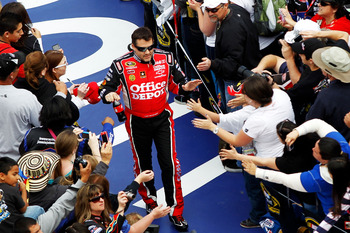 Tony Stewart high-fives his many fans
