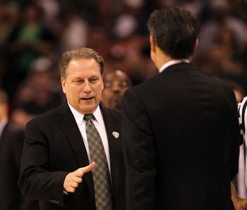 Tom Izzo and Rick Pitino shake hands after Louisville's win over Michigan State.