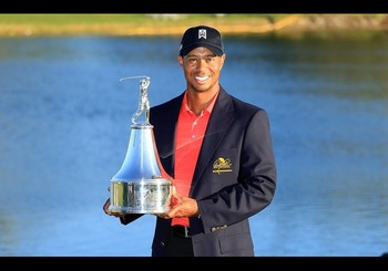 Woods holding the API trophy