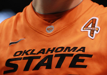 Embroidered emblem to remember the four from the OSU family, including women's basketball coach Kurt Budke, that were lost in a plane crash in November