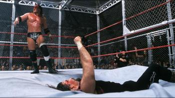 Triple H sent Cactus Jack through the ring in his first Hell in a Cell match.