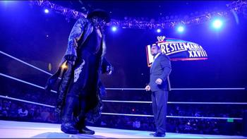 Try as he might, the Undertaker doesn't scare Triple H.